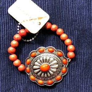 Jewelry - Red beaded bracelet with medallion. ❤️❤️